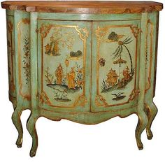 An 18th Century Venetian Bombe Polychrome and Parcel Gilt Cabinet, the marbleized top above two doors opening to reveal a large central cabi...