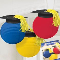 Add these adorable graduation cap hanging lanterns to your graduation party decor!