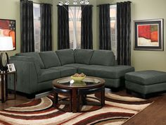 Curl up on this Oakdale two-piece sectional and enjoy the comfortable, thick cushions on the back and seats. High-density foam provides plenty of seat support, whether you're sitting back to enjoy some TV or stretched out to read. A chic grey tone adds a refined touch to your living room, while wood legs and button tufting on the sides keep the style casually sophisticated. Microsuede upholstery keeps the sectional delightfully soft, and can be cleaned with a quick vacuuming.