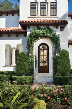 Home Inspiration: Enhance Your Mediterranean Style Entrance with a Gorgeous Front Door If you're looking to enhance your Mediterranean home, then look no further. Mediterranean Homes Exterior, Mediterranean House Plans, Mediterranean Architecture, Mediterranean Home Decor, Home Architecture, Spanish Architecture, Spanish Style Homes, Spanish House, Spanish Revival