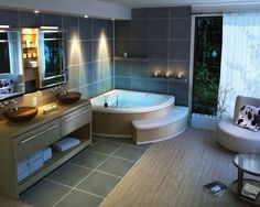 Salle de bain avec baignoire d'angle et carrelage gris anthracite