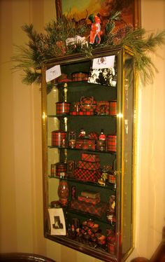 My collection of tartan ware in an old brass and glass display case, Christmas 2011