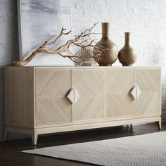 PALECEK SLOANE SIDEBOARD Sideboard features pencil pole rattan hand-set in a diamond shaped design with a hardwood frame and legs all in a white wash finish accented with fossilized clam handles. Luxury Furniture, Home Furniture, Furniture Design, Transitional Home Decor, Modern Buffet, Piece A Vivre, Cabinet Design, Future House, Sideboard