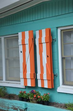 Nothing says beach like vertical white and orange striped shutters...