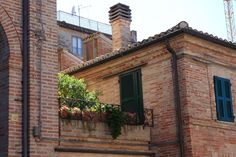 Recanati, Marche, Italy - homeland of Giacomo Leopardi. Village with particular flowered balcony by Celo Risi