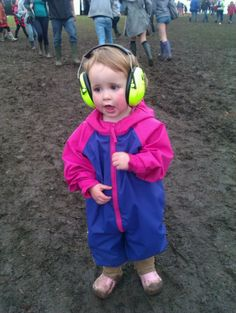 Muddy festival Kids have fun - see www.festivalkidz.com for tips on how to cope with muddy festivals with a family in tow