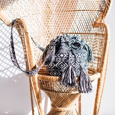 Price €14.90 Small bag is decorated by tassels and Indian pattern. It will revive every simple outfit. It has got two different parts inside and a zipped pocket.   Material: 100% polyester Measurements: 32 x 25 x 13 cm (W xH x D) Shoulder strap lenght: 124cm Regular Price: €17.53  Price €14.90 Handbag Patterns, Indian Patterns, Simple Outfits, Straw Bag, Shoulder Strap, Fashion Accessories, Tote Bag, Handbags, Tassels