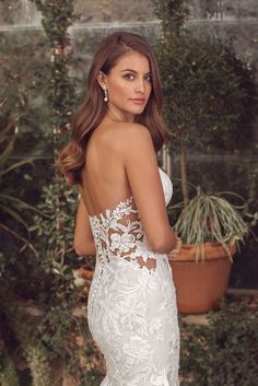 Fall in love with this sweetheart fit and flare gown. With cotton lace and illusion side cutouts that extend into the back. A horsehair hem and buttons add extra detail. Pair with the matching cathedral length veil to complete this romantic and sexy style. A version of this style is also available with the side cutouts lined.
