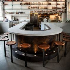 Marble circular bar & glass shelving