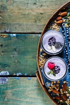 #Healthy berry smoothie  Glass jars of fruits smoothie with pumpkin and chia seeds on old rusty iron background over rustic wood table top view selective focus. Detox Diet Well being and weight loss concept