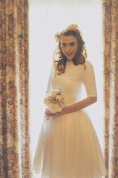 How adorable is this bride? And the brides mother made the dress! Photo Jessica Tremp