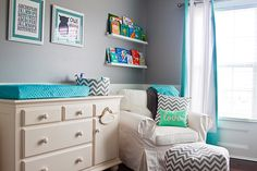Touches of #chevron in this gray and aqua nursery