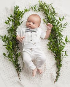 This baby boy tuxedo onesie and legging set is perfect to dress your little guy up for his blessing or christening. Would make a perfect baby shower gift. A white onesie, with small triangle print white fabric pleated bib collar sewn to the front to make it look like a tuxedo shirt. A