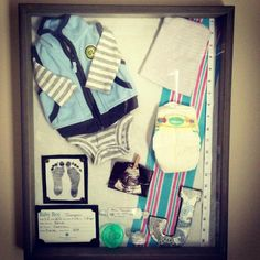 Shadowbox for Jace.  Going home outfit, cap after birth, tape that measured his length, newborn diaper, ultrasound photo, infant paci, infant bracelet, foot prints (used brads to make it look framed, bassinet ID (used buttons to frame) wooden letter covered in scrapbook paper.  FOREVER treasure!!! Baby boy shadow box