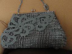 borsa in tessuto con applicazioni crochet