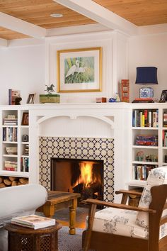 Heath tile fireplace living room farmhouse with card side table built-in bookshelves