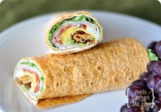 Smoked Turkey Cobb Wraps:: lettuce, tomato, bacon, hard-boiled egg, turkey and avocado on a wrap with cream cheese schmear