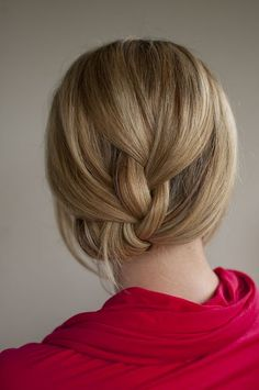 Tucked braid.  Not usually a fan of wearing my hair up in anything other than a bun, but this is cute!
