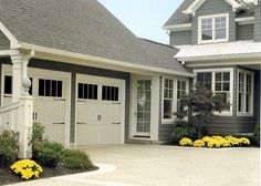 Garage Doors - i like the way this one is attached and landscaped.. just what we're looking for!