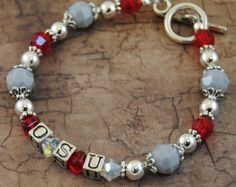 I need to make this to wear on game days Diy Jewelry, Beaded Jewelry, Jewelry Making, Jewelry Ideas, Jewelry Bracelets, Ohio State Crafts, Buckeye Crafts, Football Bracelet, Christmas Ornament Crafts