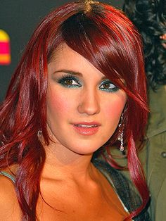 Mexican actor Dulce Maria with trademark stunning red hair color.