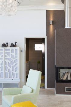 Tunto Kivi -pinnoitteella modernia jälkeä niin seiniin kuin tulisijaan.