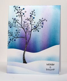 handcrafted winter card ... silhouette tree embossed in black ... snowbanks from masked landscape lines ... sky with sponging that has Northern lights look .... gorgeous card ... Penny Black stamp: