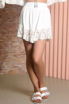 Romantic white skirt by Somedays Lovin in boho chic style made from soft, lightweight material. Features include: high waist fit with front panel, elasticated waistline and pretty floral lace panel hem.