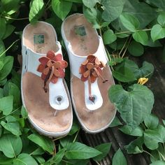 El Naturalista Sandals In excellent used condition. Few marks. Suede insole, rubber outsole. Leather flower on instep strap. Very good arch support. Gently worn. Made in Spain. El Naturalista Shoes Sandals