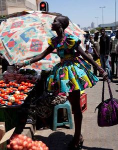I'll have some tomatoes with my fabulousness please? Who says you can't be glamorous when shopping in the market ehn?