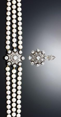 CULTURED PEARL AND DIAMOND COLLIER DE CHIEN. Designed as three uniform rows of cultured pearls to a central motif of stylised star design set with cushion-shaped, circular- and rose-cut diamonds, length approximately 410mm, central motif 1880s, detachable with diamond suspension loop and detachable brooch fittings, fitted case by Hunt & Roskell, Late Storr & Mortimer, London.