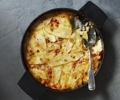 Tartiflette recipe - Preheat oven to 200°C. Heat oil in a shallow casserole over medium heat. Add onion, garlic, bacon and pancetta and cook until onion is soft (8-10 minutes).
