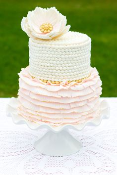 Striking two-tier cake with ruffles! See More: http://thebridaldetective.com/blush-pink-gold-wedding-inspiration/