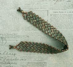 Linda's Crafty Inspirations: Bracelet of the Day - Half Tila Herringbone - Metallic Patina Seed Bead Jewelry, Bead Jewellery, Beaded Jewelry, Beaded Necklace, Beaded Bracelets, Beaded Bracelet Patterns, Jewelry Patterns, Beading Patterns, Diy Jewelry Projects