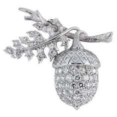 Diamond Acorn Pin  Unknown maker  20th-21st Century  Platinum acorn and leaf pin consisting of pave set round brilliant cut diamond accents having a total weight of approximately 2.80 carats.  Shreve Crump & Low