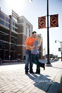 Take your engagement picture in front of your favorite sports team or where you both went to college.