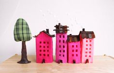 Four buildings of felt, with a tree. Miniature. Decoration.