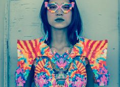 Melting-Pot by Sabine Ducasse// A Technicolor 8-Bit Pixel Collection made out of Melted-Beads   Shanghai-based designer Sabine Ducasse created the patterns of her 2012 collection by using the simple process of ironing Perler beads until they stick together to create colourful pixel-like garments. This results in these awesome intricate psychedelic patterns that look like decorative armor!  Photographer: Matthias HOSSANN  Model: Ding Rouyin