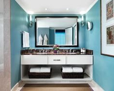 The full marble bathroom features a spacious walk-in shower, double-sink vanity and an in-mirror television. A second full bathroom offers convenience for company.
