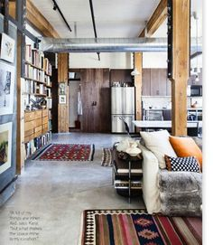Concrete Floors. Textiles. clean, bright colors. Exposed book shelves. Warm wood. Lovely.