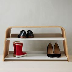 Amazing shoe rack and bench all in one by Universal Expert Shoe Bench | West Elm. At $160/each, these are pricey.