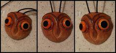 """""""Eule"""" Avokadokernhälfte, geschnitzt, lackiert und mit 2 selbst gemachten Glasaugen."""