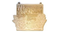 """FH Burnett Secret Garden Literary Quote Wall Art - Where You Tend a Rose My Lad a Thistle Cannot Grow - 10 in by 8.25 in - Birch. Add a literary touch to your favorite space to plan your garden with the F.H. Burnett """"Where you tend a rose"""" wall art in birch, featuring the quote """"Where you tend a rose, my lad, a thistle cannot grow"""" from her book """"The Secret Garden"""". The wall art measures just under 10 inches wide (25.4 cm) and 8.25 inches high (21 cm) and is laser cut and engraved in…"""