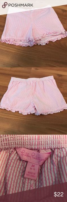 Lilly Pulitzer little girls shorts Lilly Pulitzer Little girls seersucker shorts with ruffled bottom is pink and white striped there is a slight spot in picture number four it comes off darker than it is in real life but there is a small spot on the back left side of the shorts not noticeable unless you're looking for it. Lilly Pulitzer Bottoms Shorts
