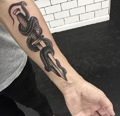 Snake with Sword Tattoo. This tattoo can be used to depict the defense and revenge at the same time.