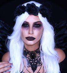 un maquillage demon dramatique et glamour, déguisement d'ange déchu femme avec costume de style gothique, couronne de roses noires et un collier dentelle noire, maquillage yeux avec des veines apparentes