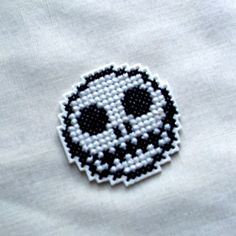 Hey, I found this really awesome Etsy listing at http://www.etsy.com/listing/115950325/grinning-skull-cross-stitch-pendant-pin