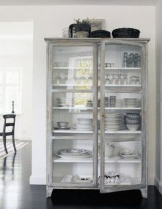 Glass front cabinet for dish storage