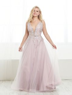 Style 16452 from Tiffany Designs is an ethereal tulle plus size A-line gown that features a striking rhinestone V-neckline with lace applique bodice and waist and an open back. Plus Prom Dresses, Plus Size Long Dresses, Tiffany Dresses, Plunging Neckline Dress, Elegant Ball Gowns, Perfect Prom Dress, Tulle Gown, A Line Gown, Pageant Dresses