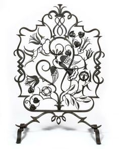 A WROUGHT IRON FIRE SCREEN BY EDGAR BRANDT, 1925.